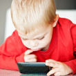 Little boy with media player — Stock Photo