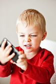 Boy with media player — Stock Photo