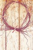 Old wreath on wooden door — Stock Photo