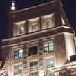 Fragment of office building at night — Stock Photo