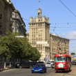 Stock Photo: Blue car and red tram