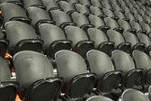 The empty black seats — Stock Photo