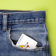 Playing card in blue jeans pocket — Stockfoto