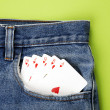 Playing cards in blue jeans pocket — Stock Photo #8559760