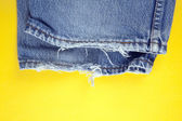 Frayed denim jeans — Stock Photo
