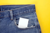 Blank paper in the jeans pocket — Stock Photo