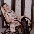 Girl in a rocking chair — Stock Photo