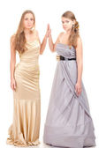 Two rival girls in gold and silver dress — Stock Photo