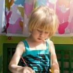 Baby girl painting — Stock Photo