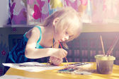 Baby girl painting — Stock Photo