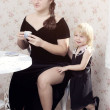 Two sisters - the eldest and the youngest in black dresses — Stock Photo #8116732
