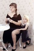 Two sisters - the eldest and the youngest in black dresses — Stock Photo