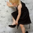 The little girl measures the mother's shoes with heels — Stok fotoğraf