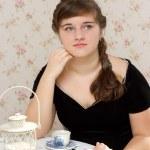 Thoughtful woman drinking coffee — Stock Photo #9853871