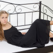Beautiful girl lying on the bed — Stock Photo