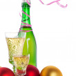 Christmas balls and bottle of champagne — 图库照片