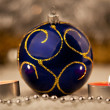 Blue Christmas ball and a candles — Stok fotoğraf