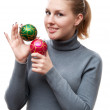 Girl holding christmas balls — Stock Photo