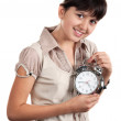 Little girl with an alarm clock - Stock Photo