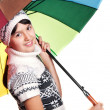 Portrait of a girl in winter clothes with colored umbrella — Stock Photo