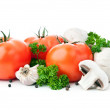 Fresh red tomato and mushrooms — Stock Photo