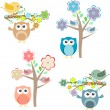 Blooming tree and branches with sitting owls and birds — Stock Vector