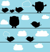 Silhouette of birds owl on a wire with clouds — Stock Vector