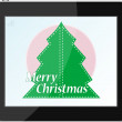 Royalty-Free Stock Векторное изображение: Christmas tree in table pc