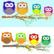Stock Vector: Family of owls sat on a tree branch at night and day