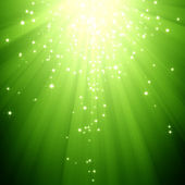 Glitter stars descending on green light burst — Stok fotoğraf