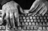 Hand on the keyboard — Stock Photo