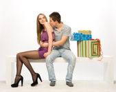The boy gives the girl gifts — Stock Photo