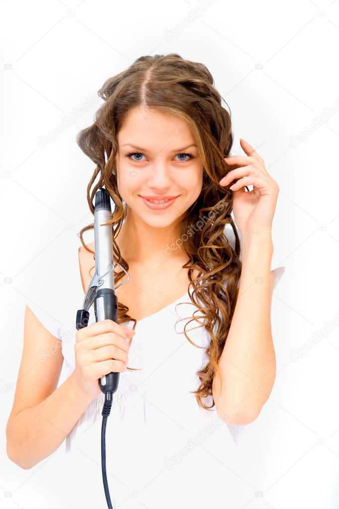 A young girl with beautiful eyes looking at the camera and keeps curling  Stockfoto #9121779