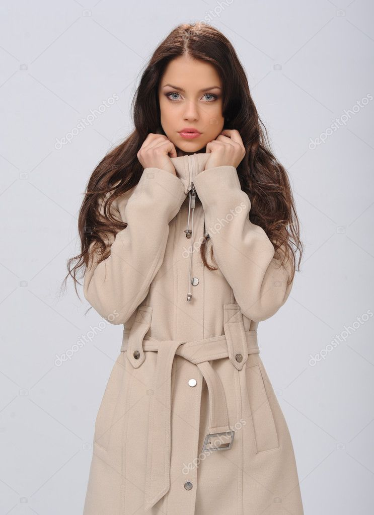 Beautiful girl in a coat on a white background — Stock Photo #9387810