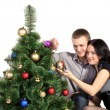 Family mand woman, dress up Christmas tree — Stock Photo #8060786