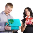 A man and a woman with gifts in hand — Stock Photo