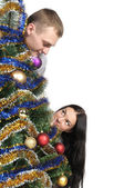 Man and woman staring at each nodule because of the Christmas Tr — Стоковое фото