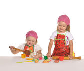 Two little housewifes in colourful aprons isolated on white back — Stock Photo