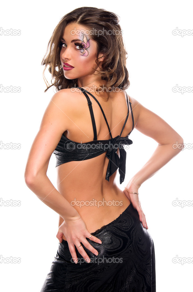 Beautiful dark haired girl with sexy back and professional visage  dancing — Stock Photo #8516659