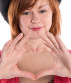 St. valentine's day young red haired girl with heart shaped fing — Stock Photo