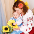 Mother and child in the Ukrainian national costumes — Stock Photo #8986396
