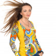 Beautiful girl  with long flying hair wearing colourful blouse — Stock Photo
