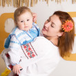 Mother and child in the Ukrainian national costumes — Stock Photo