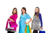 Group of pregnant women with shopping bags — Stock Photo