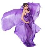 Graceful girl in flying purple silk dress — Stock Photo #9571472
