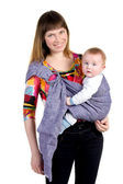 Young mother with baby in sling — Stock Photo