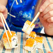 Sushi with salmon take two sticks — Stock Photo