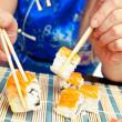 Sushi with salmon take two sticks — Stock Photo