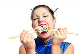 Girl eats two sushi immediately — Stock Photo