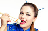 Girl eating sushi — Stock Photo